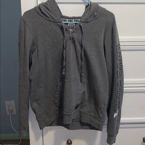 gray pullover VS Pink